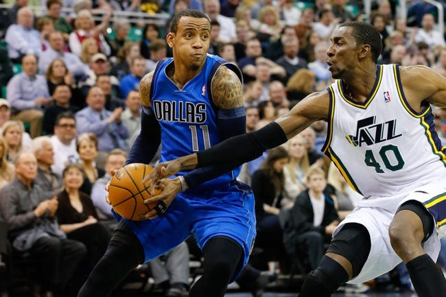 Mar 12, 2014; Salt Lake City, UT, USA; Dallas Mavericks guard Monta Ellis (11) goes to the basket while being guarded by Utah Jazz guard Alec Burks (10) during the second quarter at EnergySolutions Arena. Mandatory Credit: Chris Nicoll-USA TODAY Sports
