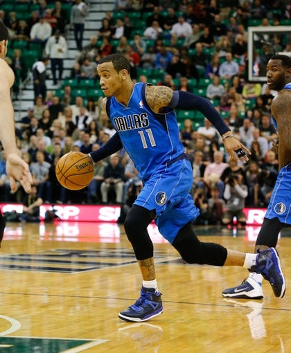 Mar 12, 2014; Salt Lake City, UT, USA; Dallas Mavericks guard Monta Ellis (11) goes to the basket during the second quarter against the Utah Jazz at EnergySolutions Arena. Mandatory Credit: Chris Nicoll-USA TODAY Sports