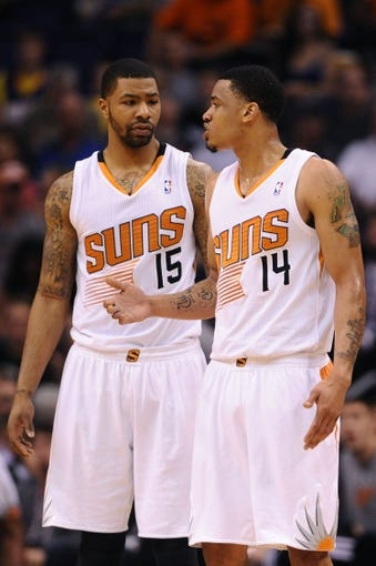 Mar 12, 2014; Phoenix, AZ, USA; Phoenix Suns forward Marcus Morris (15) talks with guard Gerald Green (14) against the Cleveland Cavaliers in the first half at US Airways Center. Mandatory Credit: Jennifer Stewart-USA TODAY Sports