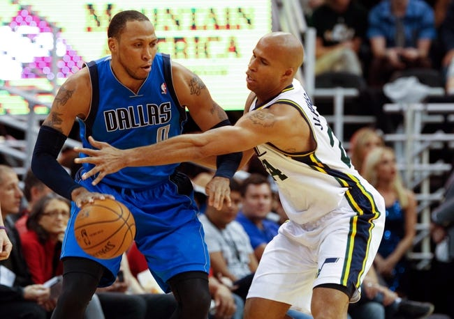 Mar 12, 2014; Salt Lake City, UT, USA; Dallas Mavericks forward Shawn Marion (0) keeps the ball away from Utah Jazz forward Richard Jefferson (24) during the third quarter at EnergySolutions Arena. Mandatory Credit: Chris Nicoll-USA TODAY Sports