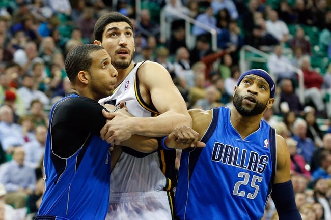 Mar 12, 2014; Salt Lake City, UT, USA; Utah Jazz center Enes Kanter (0) is works for position between Dallas Mavericks forward Brandan Wright (34) and Dallas Mavericks guard Vince Carter (25) during the third quarter at EnergySolutions Arena. Mandatory Credit: Chris Nicoll-USA TODAY Sports