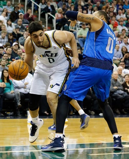 Mar 12, 2014; Salt Lake City, UT, USA; Utah Jazz center Enes Kanter (0) is fouled by Dallas Mavericks forward Shawn Marion (0) during the fourth quarter at EnergySolutions Arena. Mandatory Credit: Chris Nicoll-USA TODAY Sports