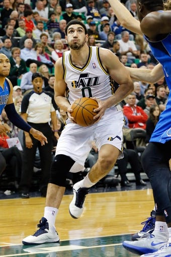Mar 12, 2014; Salt Lake City, UT, USA; Utah Jazz center Enes Kanter (0) goes to the basket during the fourth quarter against the Dallas Mavericks at EnergySolutions Arena. Mandatory Credit: Chris Nicoll-USA TODAY Sports