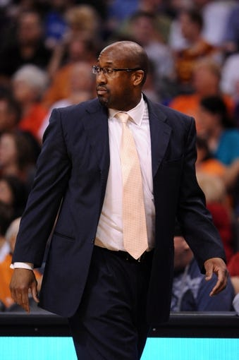 Mar 12, 2014; Phoenix, AZ, USA; Cleveland Cavaliers head coach Mike Brown walks the sidelines against the Phoenix Suns at US Airways Center. The Cavaliers won 110-101.  Mandatory Credit: Jennifer Stewart-USA TODAY Sports