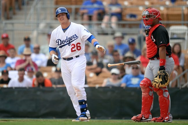Mar 13, 2014; Phoenix, AZ, USA; Los Angeles Dodgers catcher Tim Federowicz (26) heads to first base after being hit by a pitch in the third inning of a spring training game against the Cincinnati Reds at Camelback Ranch. Mandatory Credit: Joe Camporeale-USA TODAY Sports