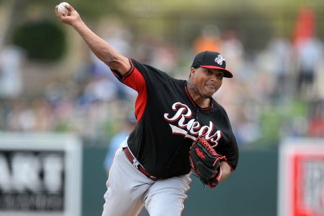 Mar 13, 2014; Phoenix, AZ, USA; Cincinnati Reds relief pitcher Alfredo Simon (31) pitches in the fourth inning of a spring training game against the Los Angeles Dodgers at Camelback Ranch. Mandatory Credit: Joe Camporeale-USA TODAY Sports
