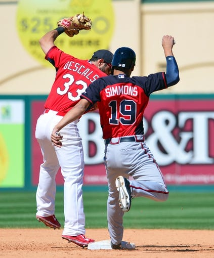 Mar 13, 2014; Jupiter, FL, USA; St. Louis Cardinals shortstop Daniel Descalso (33) beats Atlanta Braves shortstop Andrelton Simmons (19) to second base on a force play at Roger Dean Stadium. The Cardinals defeated the Braves 11-0. Mandatory Credit: Scott Rovak-USA TODAY Sports