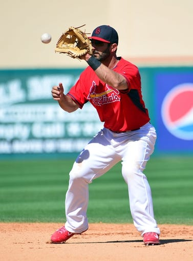 Mar 13, 2014; Jupiter, FL, USA; St. Louis Cardinals shortstop Daniel Descalso (33) makes a play against the Atlanta Braves at Roger Dean Stadium. The Cardinals defeated the Braves 11-0. Mandatory Credit: Scott Rovak-USA TODAY Sports