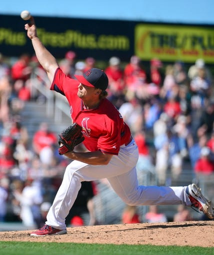 Mar 13, 2014; Jupiter, FL, USA; St. Louis Cardinals relief pitcher Trevor Rosenthal (26) delivers a pitch against the Atlanta Braves at Roger Dean Stadium. The Cardinals defeated the Braves 11-0. Mandatory Credit: Scott Rovak-USA TODAY Sports