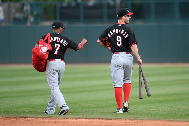Mar 13, 2014; Phoenix, AZ, USA; Cincinnati Reds shortstop Ramon Santiago (7) and Cincinnati Reds third baseman Jack Hannahan (9) leave the spring training game against the Los Angeles Dodgers at Camelback Ranch. Mandatory Credit: Joe Camporeale-USA TODAY Sports