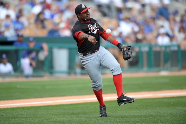 Mar 13, 2014; Phoenix, AZ, USA; Cincinnati Reds catcher Brayan Pena (29) throws to first base after fielding a bunt by Los Angeles Dodgers shortstop Dee Gordon (not pictured) in the seventh inning of a spring training game at Camelback Ranch. Mandatory Credit: Joe Camporeale-USA TODAY Sports