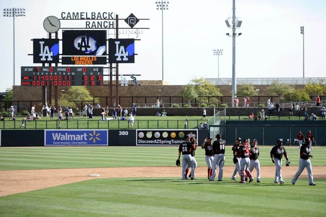 Mar 13, 2014; Phoenix, AZ, USA; Cincinnati Reds players celebrate after defeating the Los Angeles Dodgers at Camelback Ranch. The Reds won 8-2. Mandatory Credit: Joe Camporeale-USA TODAY Sports