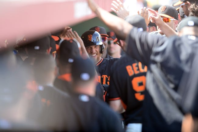 Mar 14, 2014; Scottsdale, AZ, USA; San Francisco Giants right fielder Hunter Pence (8) is congratulated by teammates in the dugout after hitting a solo home run n the second inning against the Colorado Rockies at Scottsdale Stadium. Mandatory Credit: Joe Camporeale-USA TODAY Sports