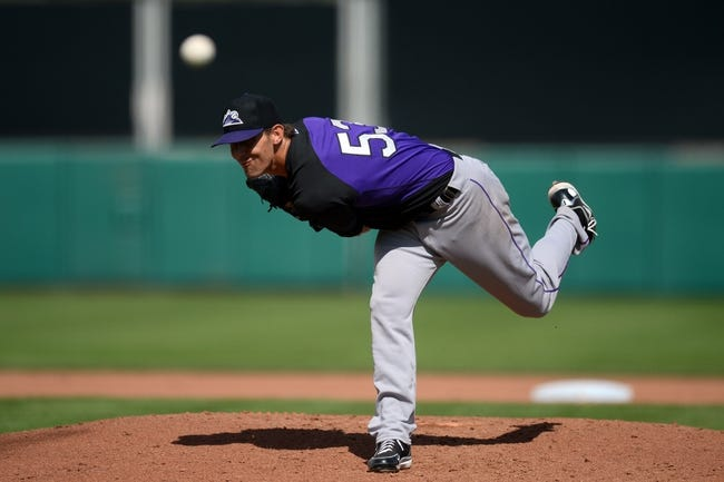 Mar 14, 2014; Scottsdale, AZ, USA; Colorado Rockies starting pitcher Christian Friedrich (53) pitches against the San Francisco Giants in the fourth inning at Scottsdale Stadium. Mandatory Credit: Joe Camporeale-USA TODAY Sports