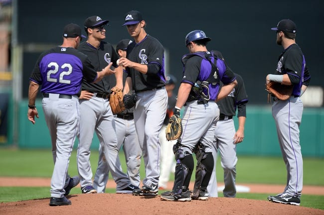 Mar 14, 2014; Scottsdale, AZ, USA; Colorado Rockies manager Walt Weiss (22) pulls Colorado Rockies starting pitcher Christian Friedrich (53) out of the game in the fourth inning at Scottsdale Stadium. Mandatory Credit: Joe Camporeale-USA TODAY Sports