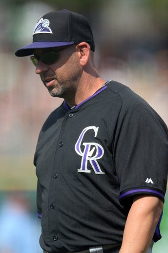 Mar 14, 2014; Scottsdale, AZ, USA; Colorado Rockies manager Walt Weiss (22) walks to the dugout in the fourth inning against the San Francisco Giants at Scottsdale Stadium. Mandatory Credit: Joe Camporeale-USA TODAY Sports