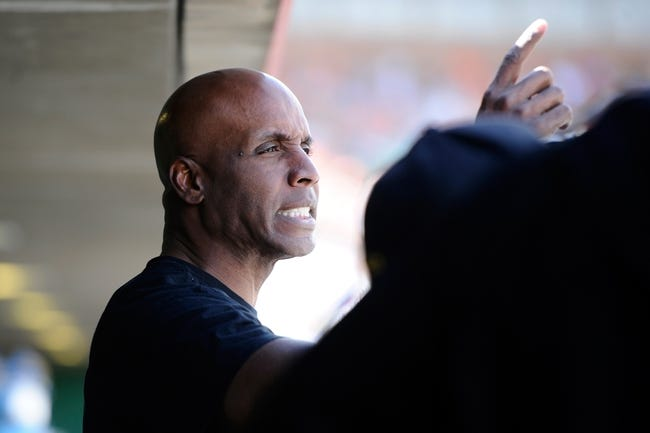 Mar 14, 2014; Scottsdale, AZ, USA; Former San Francisco Giants outfielder Barry Bonds watches from the dugout against the Colorado Rockies at Scottsdale Stadium. The Giants won 4-0. Mandatory Credit: Joe Camporeale-USA TODAY Sports
