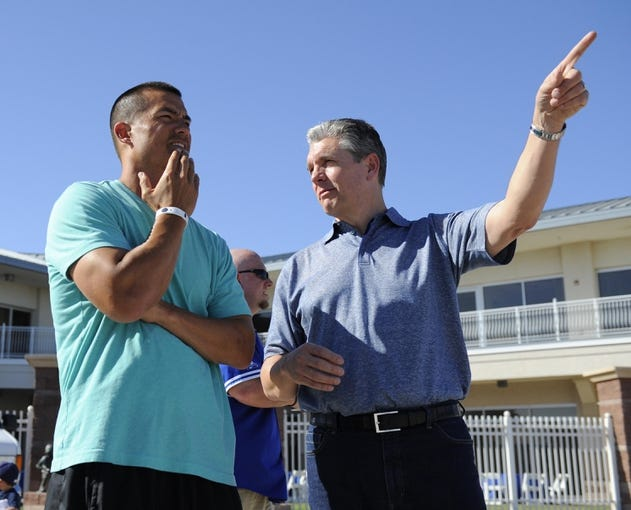Mar 15, 2014; Surprise, AZ, USA; Sports agent Casey Close talks with a client Kansas City Royals pitcher Jeremy Guthrie (left) during the  Royals spring training game against the Chicago Cubs at Surprise Stadium. Mandatory Credit: Christopher Hanewinckel-USA TODAY Sports
