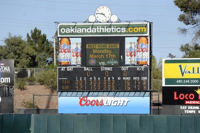 Mar 15, 2014; Phoenix, AZ, USA; A view of the scoreboard after the game between the Oakland Athletics and the Texas Rangers at Phoenix Municipal Stadium. The Rangers won 16-15. Mandatory Credit: Joe Camporeale-USA TODAY Sports