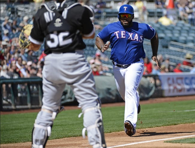 Mar 16, 2014; Surprise, AZ, USA; Texas Rangers first baseman Prince FIelder (84) scores during the first inning against the Chicago White Sox at Surprise Stadium. Mandatory Credit: Christopher Hanewinckel-USA TODAY Sports