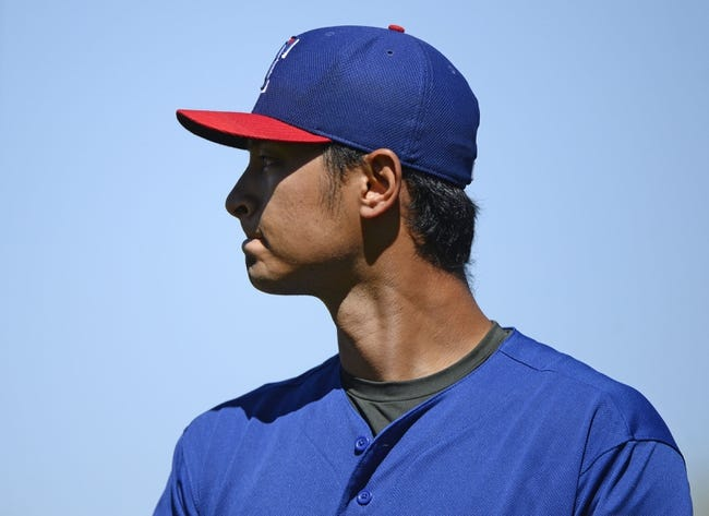 Mar 16, 2014; Surprise, AZ, USA; Texas Rangers starting pitcher Yu Darvish (11) after the third inning against the Chicago White Sox at Surprise Stadium. Mandatory Credit: Christopher Hanewinckel-USA TODAY Sports
