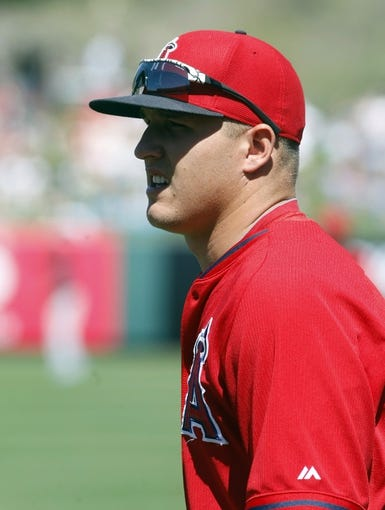 Mar 16, 2014; Tempe, AZ, USA; Los Angeles Angels center fielder Mike Trout (27) warms up before a game against the Seattle Mariners at Tempe Diablo Stadium. Mandatory Credit: Rick Scuteri-USA TODAY Sports