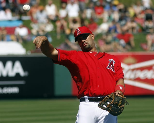 Mar 16, 2014; Tempe, AZ, USA; Los Angeles Angels first baseman Albert Pujols (5) warms up before a game against the Seattle Mariners at Tempe Diablo Stadium. Mandatory Credit: Rick Scuteri-USA TODAY Sports