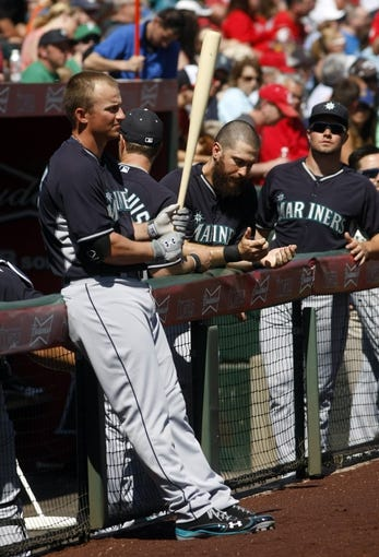 Mar 16, 2014; Tempe, AZ, USA; Seattle Mariners third baseman Kyle Seager (15) gets ready to hit before a game against the Los Angeles Angels at Tempe Diablo Stadium. Mandatory Credit: Rick Scuteri-USA TODAY Sports