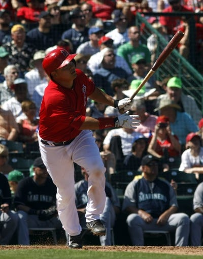 Mar 16, 2014; Tempe, AZ, USA; Los Angeles Angels catcher Hank Conger (16) hits in the sixth inning against the Seattle Mariners at Tempe Diablo Stadium. Mandatory Credit: Rick Scuteri-USA TODAY Sports