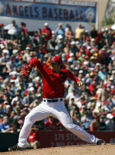 Mar 16, 2014; Tempe, AZ, USA; Los Angeles Angels starting pitcher C.J. Wilson (33) throws in the fifth inning against the Seattle Mariners at Tempe Diablo Stadium. Mandatory Credit: Rick Scuteri-USA TODAY Sports