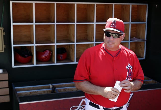 Mar 16, 2014; Tempe, AZ, USA;  Los Angeles Angels manager Mike Scioscia (14) before a game against the Seattle Mariners at Tempe Diablo Stadium. Mandatory Credit: Rick Scuteri-USA TODAY Sports