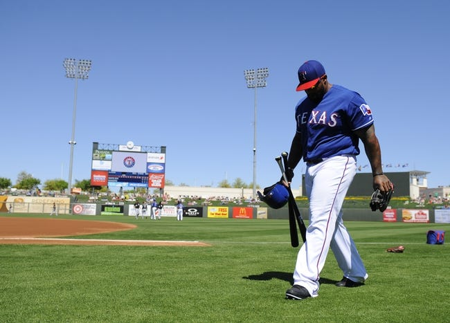 Mar 16, 2014; Surprise, AZ, USA; Texas Rangers first baseman Prince Fielder (84) walks to the dugout prior to the game against the Chicago White Sox at Surprise Stadium. Mandatory Credit: Christopher Hanewinckel-USA TODAY Sports