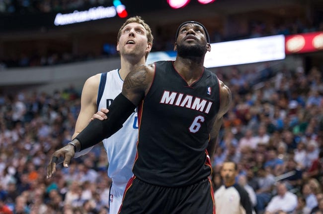 Feb 18, 2014; Dallas, TX, USA; Dallas Mavericks power forward Dirk Nowitzki (41) and Miami Heat small forward LeBron James (6) during the game at the American Airlines Center. The Heat defeated the Mavericks  117-106. Mandatory Credit: Jerome Miron-USA TODAY Sports