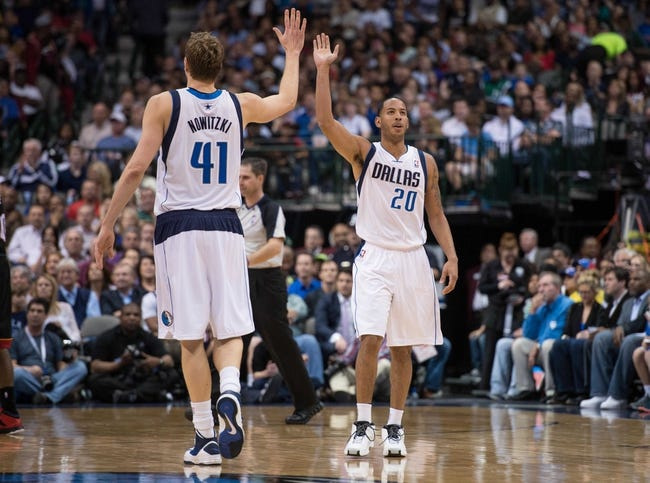 Feb 18, 2014; Dallas, TX, USA; Dallas Mavericks power forward Dirk Nowitzki (41) and point guard Devin Harris (20) during the game against the Miami Heat at the American Airlines Center. The Heat defeated the Mavericks  117-106. Mandatory Credit: Jerome Miron-USA TODAY Sports