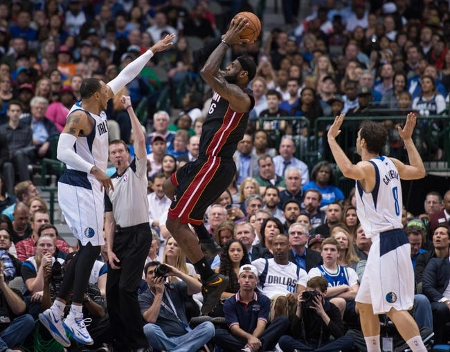 Feb 18, 2014; Dallas, TX, USA; Miami Heat small forward LeBron James (6) shoots over Dallas Mavericks small forward Shawn Marion (0) during the game at the American Airlines Center. The Heat defeated the Mavericks  117-106. Mandatory Credit: Jerome Miron-USA TODAY Sports