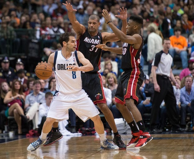 Feb 18, 2014; Dallas, TX, USA; Miami Heat small forward Shane Battier (31) and point guard Norris Cole (30) guards Dallas Mavericks point guard Jose Calderon (8) during the game at the American Airlines Center. The Heat defeated the Mavericks  117-106. Mandatory Credit: Jerome Miron-USA TODAY Sports