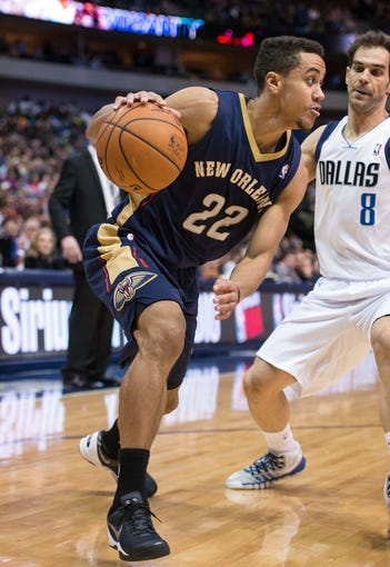 Feb 26, 2014; Dallas, TX, USA; New Orleans Pelicans point guard Brian Roberts (22) during the game against the Dallas Mavericks at the American Airlines Center. The Mavericks defeated the Pelicans 108-89. Mandatory Credit: Jerome Miron-USA TODAY Sports