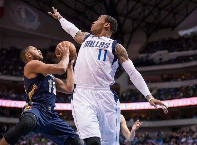 Feb 26, 2014; Dallas, TX, USA; Dallas Mavericks shooting guard Monta Ellis (11) defends against New Orleans Pelicans shooting guard Eric Gordon (10) during the game at the American Airlines Center. The Mavericks defeated the Pelicans 108-89. Mandatory Credit: Jerome Miron-USA TODAY Sports