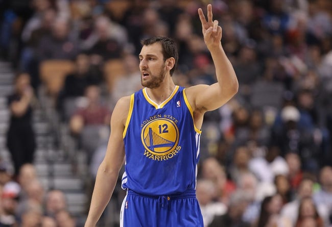 Mar 2, 2014; Toronto, Ontario, CAN; Golden State Warriors center Andrew Bogut (12) motions during their game against the Toronto Raptors at Air Canada Centre. The Raptors beat the Warriors 104-98. Mandatory Credit: Tom Szczerbowski-USA TODAY Sports