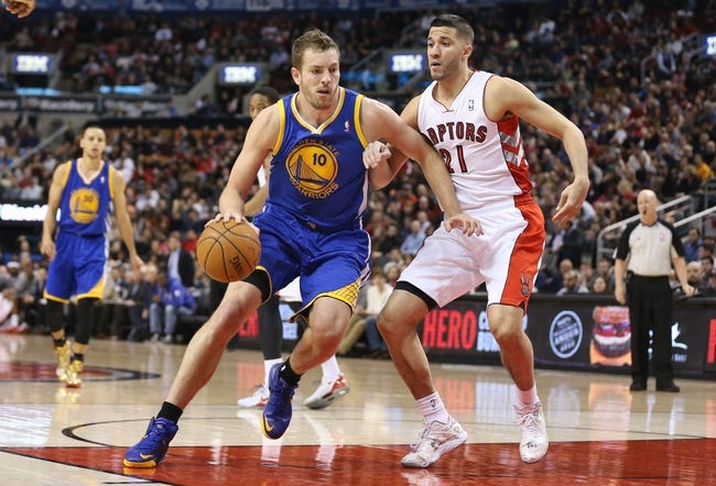 Mar 2, 2014; Toronto, Ontario, CAN; Golden State Warriors forward David Lee (10) goes to the basket past Toronto Raptors guard Greivis Vasquez (21) at Air Canada Centre. The Raptors beat the Warriors 104-98. Mandatory Credit: Tom Szczerbowski-USA TODAY Sports