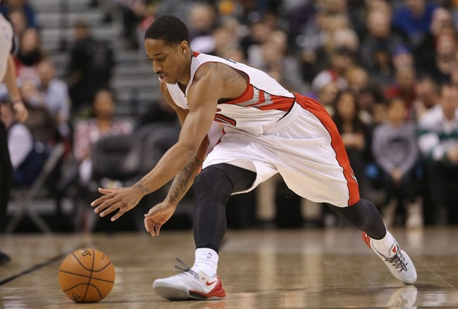 Mar 2, 2014; Toronto, Ontario, CAN; Toronto Raptors guard DeMar DeRozan (10) goes after the ball against the Golden State Warriors at Air Canada Centre. The Raptors beat the Warriors 104-98. Mandatory Credit: Tom Szczerbowski-USA TODAY Sports