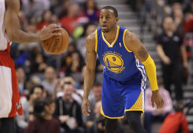 Mar 2, 2014; Toronto, Ontario, CAN; Golden State Warriors forward Andre Iguodala (9) plays defense against the Toronto Raptors at Air Canada Centre. The Raptors beat the Warriors 104-98. Mandatory Credit: Tom Szczerbowski-USA TODAY Sports