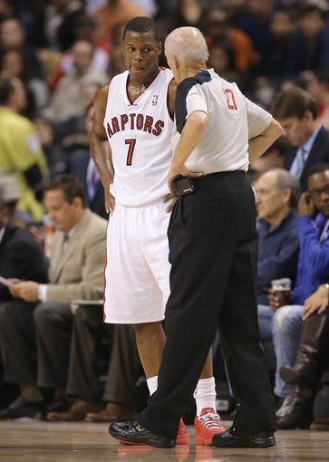 Mar 2, 2014; Toronto, Ontario, CAN; Toronto Raptors point guard Kyle Lowry (7) listens to official Dick Bavetta (27) against the Golden State Warriors at Air Canada Centre. The Raptors beat the Warriors 104-98. Mandatory Credit: Tom Szczerbowski-USA TODAY Sports