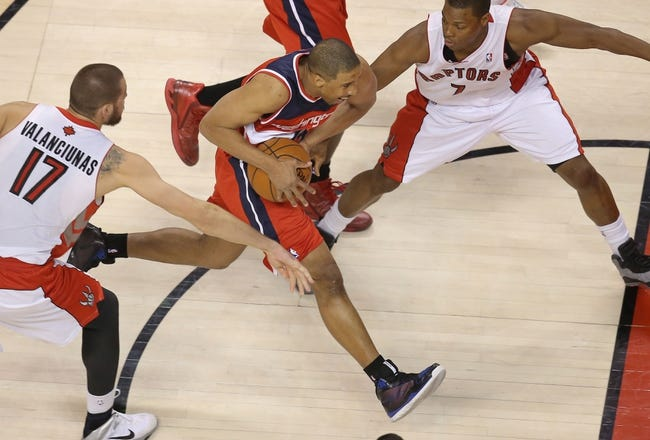 Feb 27, 2014; Toronto, Ontario, CAN; Washington Wizards guard Andre Miller (24) goes to the basket against the Toronto Raptors at Air Canada Centre. The Wizards beat the Raptors 134-129 in triple overtime. Mandatory Credit: Tom Szczerbowski-USA TODAY Sports