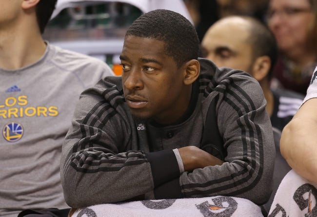 Mar 2, 2014; Toronto, Ontario, CAN; Golden State Warriors guard Jordan Crawford (55) looks on from the bench against the Toronto Raptors at Air Canada Centre. The Raptors beat the Warriors 104-98. Mandatory Credit: Tom Szczerbowski-USA TODAY Sports