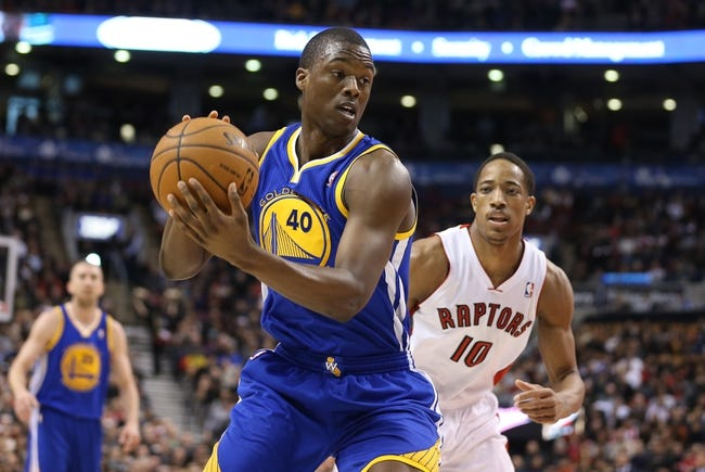 Mar 2, 2014; Toronto, Ontario, CAN; Golden State Warriors forward Harrison Barnes (40) turns with the ball as Toronto Raptors guard DeMar DeRozan (10) watches at Air Canada Centre. The Raptors beat the Warriors 104-98. Mandatory Credit: Tom Szczerbowski-USA TODAY Sports