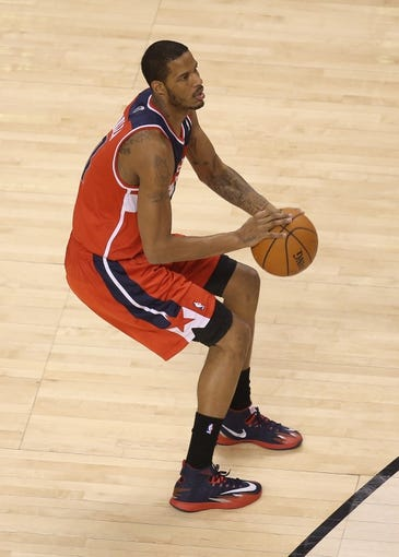 Feb 27, 2014; Toronto, Ontario, CAN; Washington Wizards forward Trevor Ariza (1) prepares to shoot against the Toronto Raptors at Air Canada Centre. The Wizards beat the Raptors 134-129 in triple overtime. Mandatory Credit: Tom Szczerbowski-USA TODAY Sports