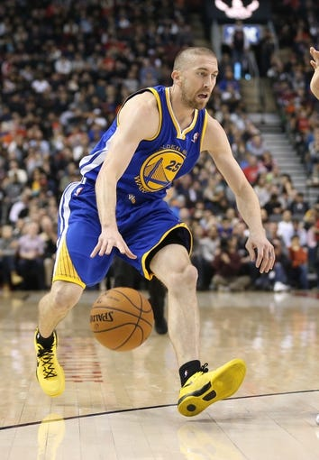 Mar 2, 2014; Toronto, Ontario, CAN; Golden State Warriors guard Steve Blake (25) dribbles against the Toronto Raptors at Air Canada Centre. The Raptors beat the Warriors 104-98. Mandatory Credit: Tom Szczerbowski-USA TODAY Sports
