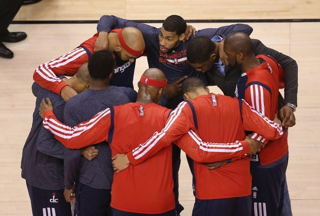 Feb 27, 2014; Toronto, Ontario, CAN; Washington Wizards players huddle before the start of their game against the Toronto Raptors at Air Canada Centre. The Wizards beat the Raptors 134-129 in triple overtime. Mandatory Credit: Tom Szczerbowski-USA TODAY Sports