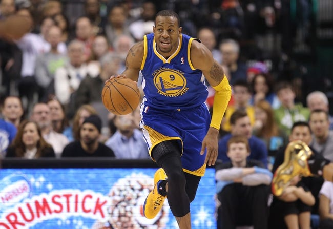 Mar 2, 2014; Toronto, Ontario, CAN; Golden State Warriors forward Andre Iguodala (9) dribbles up the court against the Toronto Raptors at Air Canada Centre. The Raptors beat the Warriors 104-98. Mandatory Credit: Tom Szczerbowski-USA TODAY Sports
